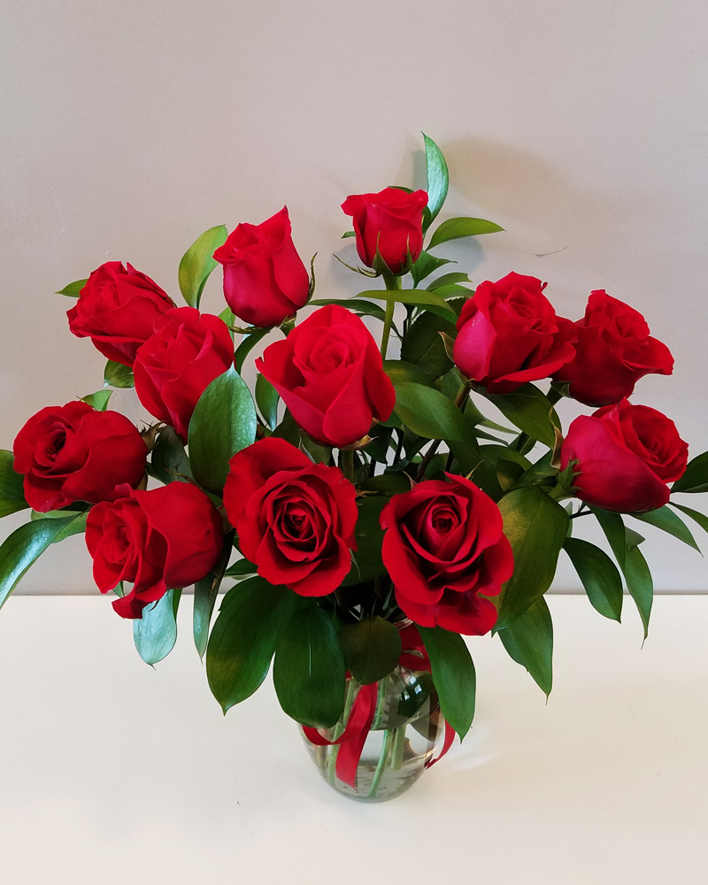 One Dozen Red Roses flower arrangement in a clear vase
